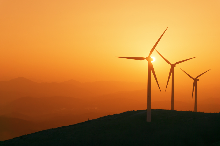 wind turbines silhouette on mountain at sunset