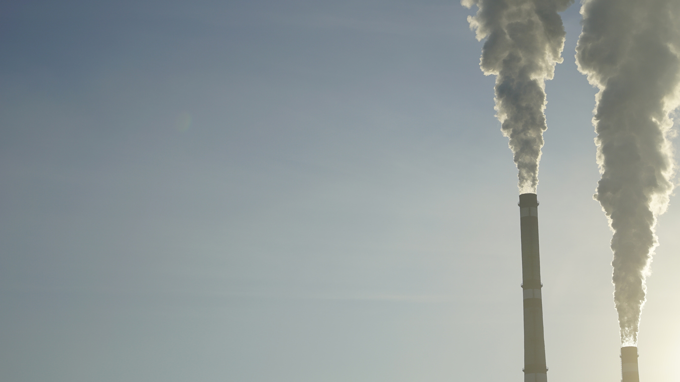 industrial chimneys emits toxic pollutants into the sky polluting the