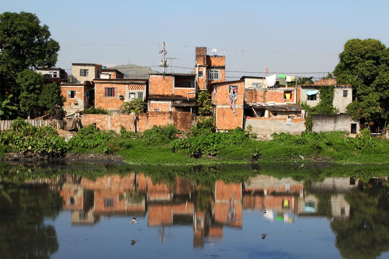 Favela at a polluted river margins